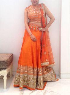 Orange color lehenga choli in Gotta patti work This exquisite orange lehenga choli is adorned with traditional gotta patti embroidery. This lehenga choli has been paired with a fully embroidered ornage raw silk choli and a net dupatta. A stunning Lehenga Designs, Half Saree Designs, Blouse Designs, Fashion Designer, Indian Designer Wear, Indian Wedding Outfits, Indian Outfits, Saris, Lehenga Choli Online