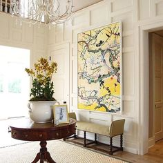 Loving the #design details in this foyer designed by David Lawrence.  #offthegrid #designstyle #interiordesign #classicdecor #artwork #grandentrance