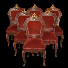 Lot #125: Set of Six Boulle Dining Chairs  DESCRIPTION:Set of six boulle dining chairs. Features wood and turtle shell boulle marquetry. Adorned with gilt bronze detailings along the frame and legs in floral motif. Each chair is garnished by a gilt bronze plaque topped with a royal crown. Finished with original red velvet upholstery.  CIRCA:19th Ct. ORIGIN:France DIMENSIONS:H: 39″ L:21″: W:18″