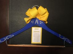 Spirit hanger, for cheer uniforms.