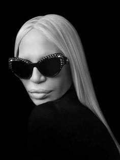"""Donatella Versace with the new sunglasses from the new eyewear collection. Donatella Versace, Gianni Versace, Gucci Sunglasses, Black Sunglasses, Cat Eye Sunglasses, Round Sunglasses, Sunnies, Lady Gaga, Versace Eyewear"