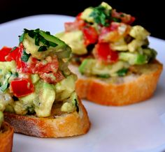 Ingredients:  	½ loaf French bread 	1 clove garlic 	2 Tablespoons olive oil 	2 tomatoes, medium chopped 	2 avocados, medium chopped 	1/3 cup finely