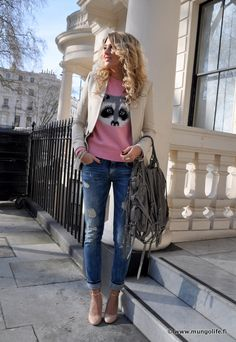 whimsical sweater made chic with blazer, heels, and oversized bag