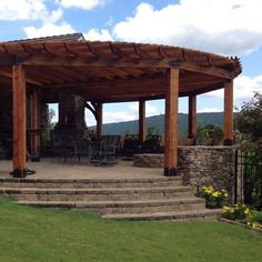 Round Pergola featuring the Post Base Kit and 45° Inside Flush Tie Plate by OZCO