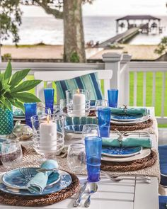 Echoing coastal views, this tabletop incorporates a spectrum of blue hues—from deep marine to aqua. Woven table runners and rattan placemats enhance the scene's laid-back tone. #southernladymag #tabletopinspo #tablescape #tablescapes #tablescapetuesday Us Labor Day, Labour Day Weekend, Southern Ladies, End Of Summer, Tablescapes, Table Settings, Table Decorations, Entertaining, Sea