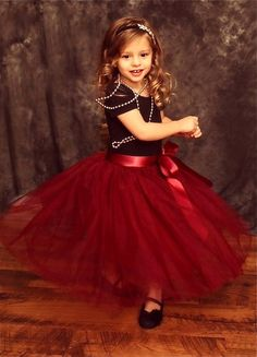 Stunning sewn (no tied) tulle skirt for your little princess. Skirt is made w/ layers of a burgundy wine tulle, fully lined with soft woven cotton, has an elastic waist, and a satin sash. This is a te