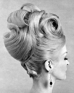 "1960s ""up-do""  style sweeping large curls & exaggerated ""french twist""..."