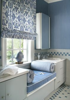 This is amazing ~ a window seat in your bathroom!   Love the Wedgewood blue color the designer used, especially the checkered tile border and floor!