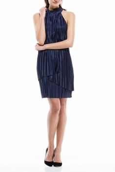 This navy halter sheath dress from Maggy London has a beautiful fabric overlay that will give you a chic and unforgettable look. Add some pizazz to this sophisticated style with chandelier earrings and a chunky bracelet.   Halter Sheath Dress by Maggy London. Clothing - Dresses - Cocktail Illinois
