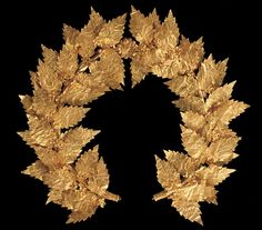 Greek Gold Wreath of Oak Leaves and Flowers, possibly from Attica, Greece, late 2nd - early 1st century BC In ancient Greece, oak leaves symbolized wisdom, and were associated with Zeus, who according to Greek mythology made his decisions while resting in an oak grove. Gold wreaths such as this one derive their form from wreaths of real leaves worn in religious ceremonies or given as prizes in athletic and artistic contests. Because of their fragility, gold wreaths were probably not meant…