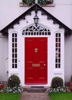 Cute red front door with sidelights.  curb appeal!