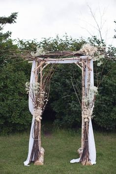 I like the rustic look of this arbor with the twigs and branches