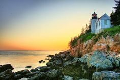 A lighthouse at sunrise in Acadia National Park in Maine.