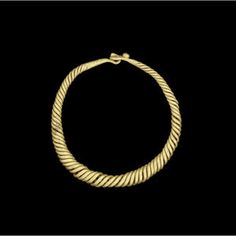 A Roman gold bracelet  Circa 2nd-3rd Century A.D. Composed of solid gold wires twisted in a spiral tapering towards the hook and loop termin...