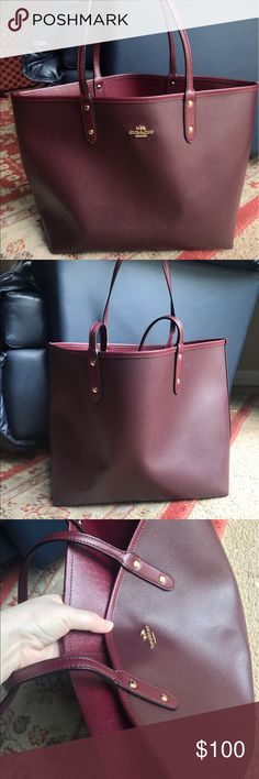 Reversible ox blood / maroon Coach tote / bag Ox blood / Maroon colored reversible large Coach tote / bag. Comes with a smaller bag to put your items in, very spacious. There are some small markings on front of bag as pictured but otherwise very gently used. No trades or Pay Pal and price is firm! Coach Bags Totes