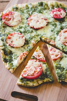 Grilled Pesto and Tomato Pizza - Simple easy recipe proves less is more. Fresh heirloom tomatoes and homemade pesto top a homemade pizza crust that is liberally sprinkled with cheese. Recipe calls for cheddar but I think buffalo mozzarella would be a winning combination. Finally the pizza is grilled on an outdoor grill.
