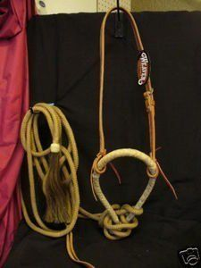 """Weaver Leather Horse Training Bosal Hackamore Pro Set by Weaver Leather. $139.99. Weaver Leather Horse Training Bosal Hackamore Pro Set : Weaver Leather Complete Mecate set With Black Reins 5/8"""" russet harness leather bosal hanger Alum tanned leather lace ties Braided nylon Mecate with a rawhide button and horsehair tassel at one end and a bleeding heart knot on the other end . This is a great training tool. ?"""