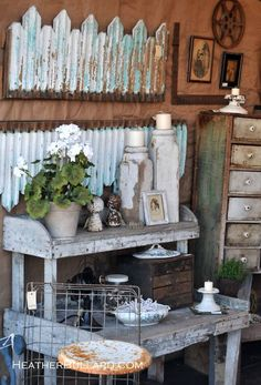 LOVE this rustic bench and I want those candle holders. All of them
