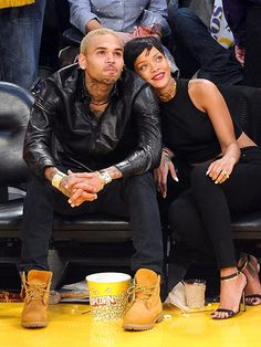 Following months of speculation, Rihanna and Chris Brown seemingly confirm they are back on, getting cozy while watching the L.A. Lakers triumph over the New York Knicks 100-94 at the Staples Center in Los Angeles.
