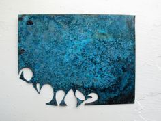A nice teal patina developed on this copper plate after I sprayed it with salt water and then left in a closed tupperware container with a bowl of ammonia for three days.