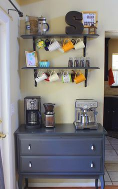 Coffee Bar created using a small dresser that could have been cut down to size and a new top applied...2 shelves above with hooks for hanging cups and plenty of counter space! I love this!