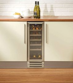 Wine Fridge - Love the simplicity and the symmetry. Also, we probably only need that small of a wine fridge anyway Kitchen Furniture, Small Wine Fridge, Kitchen Ideals, Cheap Furniture, Rental Furniture, Farmhouse Furniture, Home Kitchens, Wine Chiller Kitchen, Small Fridges
