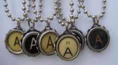 upcycled typewriter key pendants (all letters!).  so cute from www.junxtaposition.com
