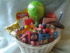 One made to order Tootsie Pop Gift Basket. An unique and affordable gift idea for that Tootsie Pop fan young and old  The basket contains: everything related to tootsie pops, every flavor pop,memo pad,sticky notes,reusable tote,pencils,pencil holder,tootsie pops drops,lipbalm,tshirt,socks, and ...