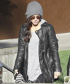 Low-key star: Sandra kept things casual in a frayed jumper, baggy leather jacket and a beanie hat