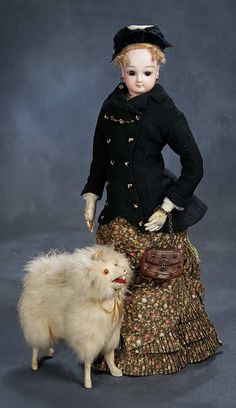 """Theriault's Antique Doll Auctions - 17"""" French Bisque Poupee in Fashionable Ensemble of 1870s by Jumeau - circa 1878 - with French Salon Dog with Amber Glass Eyes - circa 1890"""