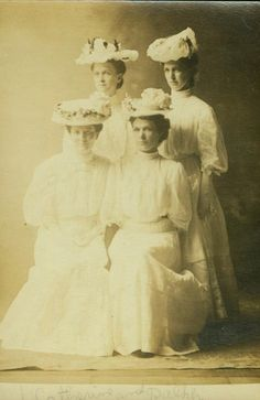 Antique real photo postcard - four young women friends (teachers?) in summer frocks and hats, circa 1910.