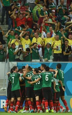 FIFA World Cup 2014 - México 3 Croacia 1 (6.23.2014) - El Nuevo Herald Mexico's players celebrate after scoring the 0-1 during a Group A football match between Croatia and Mexico at the Pernambuco Arena in Recife during the 2014 FIFA World Cup on June 23, 2014. EMMANUEL DUNAND / AFP/Getty Images