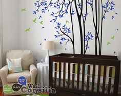 In Stock $141.00 www.wallconsilia.com Black spring tree with Green birds and Blue falling leaves could be a great addition to your baby's nursery room walls. Also could fill the empty space in the wall in your living room. Indulge your little one's imagination with this stunning vinyl wall decal set perfect for any nursery or bedroom. We think it's a great choice for gender neutral nursery!  #Trees #DIY #HomeDecor  #Birds #Unisex #GoGreen