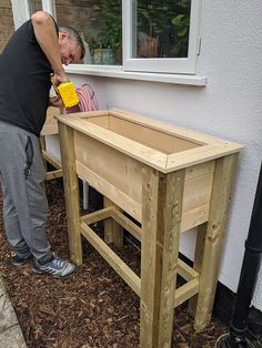 DIY Standing Raised Bed Planter - perfect for adding height and greenery to a patio or balcony and to create an easier way to grow herbs or flowers for those who have issues with mobility. #diy #diygarden #planter #diyplanter #diyraisedplanter #raisedstandingplanter #raisedbed #raisedbeddiy #uk Raised Planter Beds, Raised Beds, Black Bin, Bin Bag, Diy Planters, Growing Herbs, L Shape, Outdoor Ideas, Home Renovation