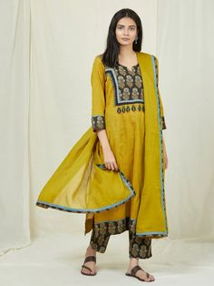 Buy Mustard Yellow Ajrakh Printed Cotton Kurta with Black Pants and Dupatta- Set of 3 online at Theloom
