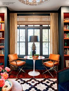 So many good things happening here: pattnered rug (or is that tile?) fab tulip table, chrome chairs, turquoise walls, velvet teal chairs. Ahhhh....