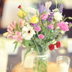 Garden flowers as centerpeices, Carnations and Lilacs (if available) to honor deceased relatives...?