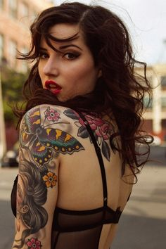 Woman with sleeve and upper back tattoos