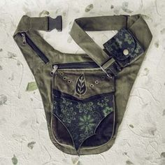 The ultimate utility belt for concerts and other adventures, our sturdy cotton canvas festival hip belt features sweet leaf embroidery and tons of pockets in different sizes, to help you carry your favorite treasures hands-free. An internal zipper pocket offers a particularly secure secret storage spot for anything you want to keep extra close.