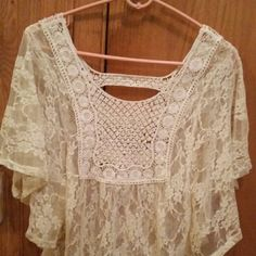 Sheer top This top is an ivory color. Really nice to wera on warm are hot days. Its new without tags Can wear tank tops underneath  are fancy bras.  The skeeves are just flowing, which makes this top elegant. Body Central Tops Camisoles