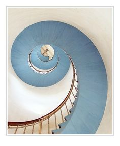 Spiral staircase in the Lyngvig Lighthouse in Denmark.  (Photograph by French Photographer Eric of Ricphotography via Pretty Stuff Tumblr).  For photographer's blog, see  http://www.ricphotography.fr/index.php?showimage=164)