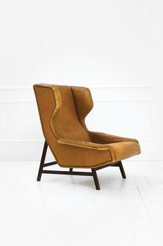 Gianfranco Frattini; #877 Walnut Lounge Chair for Cassina, 1959.
