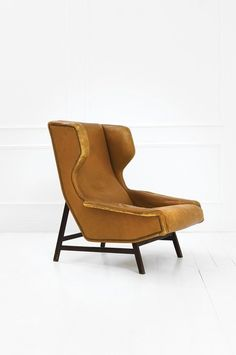 Gianfranco Frattini; #877 Walnut Lounge Chair for Cassina, 1959.