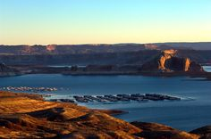 Lake Powell, 186 miles long, has sandy beaches, clear water and red-rock scenery. Part of the Glen Canyon Recreational Area, the lake has 1,960 miles of shoreline with coves, sand dunes and sunken ...