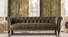 Our Regiment Chesterfield is inspired by the 1930's chesterfield variations and provides a button tufted back and sides with a deep fixed seat. Handcrafted flaring scroll arms and rows of antique brass nail head trim lend elegance and style to the silhouette. Now Available in Leather! Customise this sofa with our wide range of Scrunched and Italian Leather fabrics. http://www.gulmoharlane.com/products/regiment-leather-sofa-collection