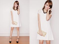 a clean cut white A shaped dress with lacey short sleeves