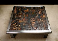 """ERIC BESSON """"Lettres"""" Cocktail Table made of hand-forged steel and vintage carved wood types from turn-of-the-century printing houses."""