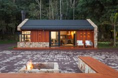 The Lake House is designed by Cadi Arquitetura, Space to meet friends and enjoy good music. The Lake House was the wish of the owner Modern Small House Design, Rustic Lake Houses, Tiny House Loft, Long House, Wooden Gates, Stone Houses, Home Design Plans, Traditional House, House Styles