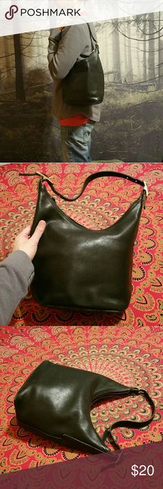 Vintage coach hobo black Nice condition vintage coach bag in black. A few small scuffs on the bottom and some spots on the inside but nothing horrible. Overall good shape! Hold quite a bit more than you'd think! Coach Bags