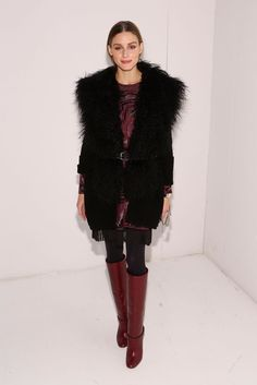 For Rachel Zoe's presentation, Olivia Palermo topped a printed dress with a furry vest.